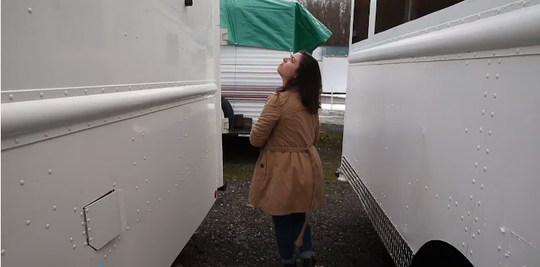 Democrat and Chronicle reporter Sarah Taddeo examines trucks found in a local storage lot, reported to be related to M Design Vehicles transactions.