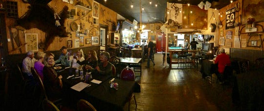 Panoramic view of the bar and dining room at the French Gulch Hotel.