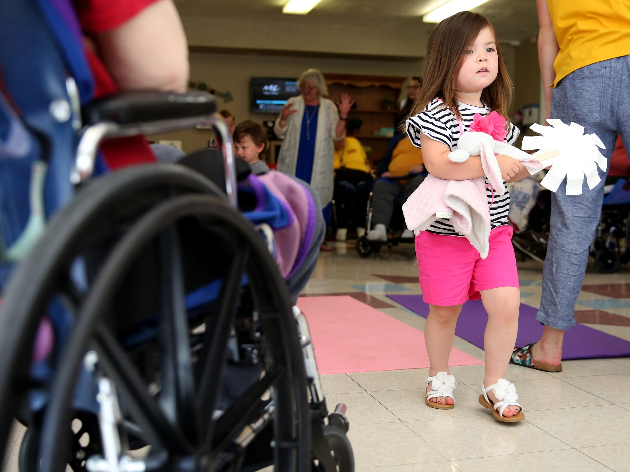 "Zora Thaggard, 3, dances during a visit by the Friendship Brigade, a group that focuses on intergenerational programming, at Avamere Transitional Care at Sunnyside in Salem on May 6, 2019. Once a week, ""Storytime at Sunnyside"" brings preschoolers to the seniors for reading, singing, dancing and other playtime activities."