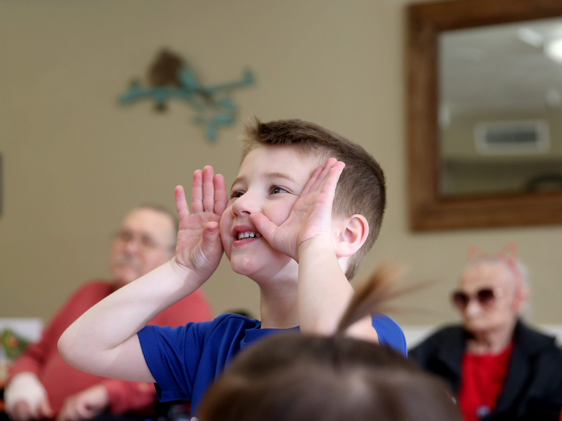 "Hank Jacobs, 5, sings along to a song during a visit by the Friendship Brigade, a group that focuses on intergenerational programming, at Avamere Transitional Care at Sunnyside in Salem on May 6, 2019. Once a week, ""Storytime at Sunnyside"" brings preschoolers to the seniors for reading, singing, dancing and other playtime activities."