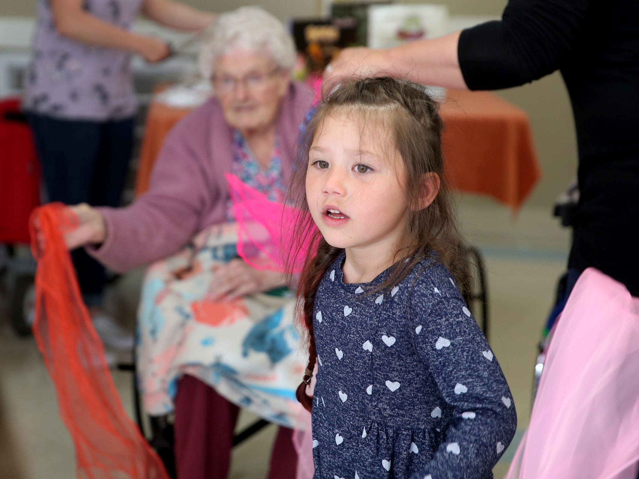 "Eva Pineda, 4, dances with scarves during a visit by the Friendship Brigade, a group that focuses on intergenerational programming, at Avamere Transitional Care at Sunnyside in Salem on May 6, 2019. Once a week, ""Storytime at Sunnyside"" brings preschoolers to the seniors for reading, singing, dancing and other playtime activities."
