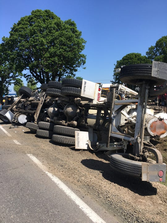 Northbound Turner Road SE is closed at Airway Drive SE after a fully-loaded cement truck slid into a ditch.