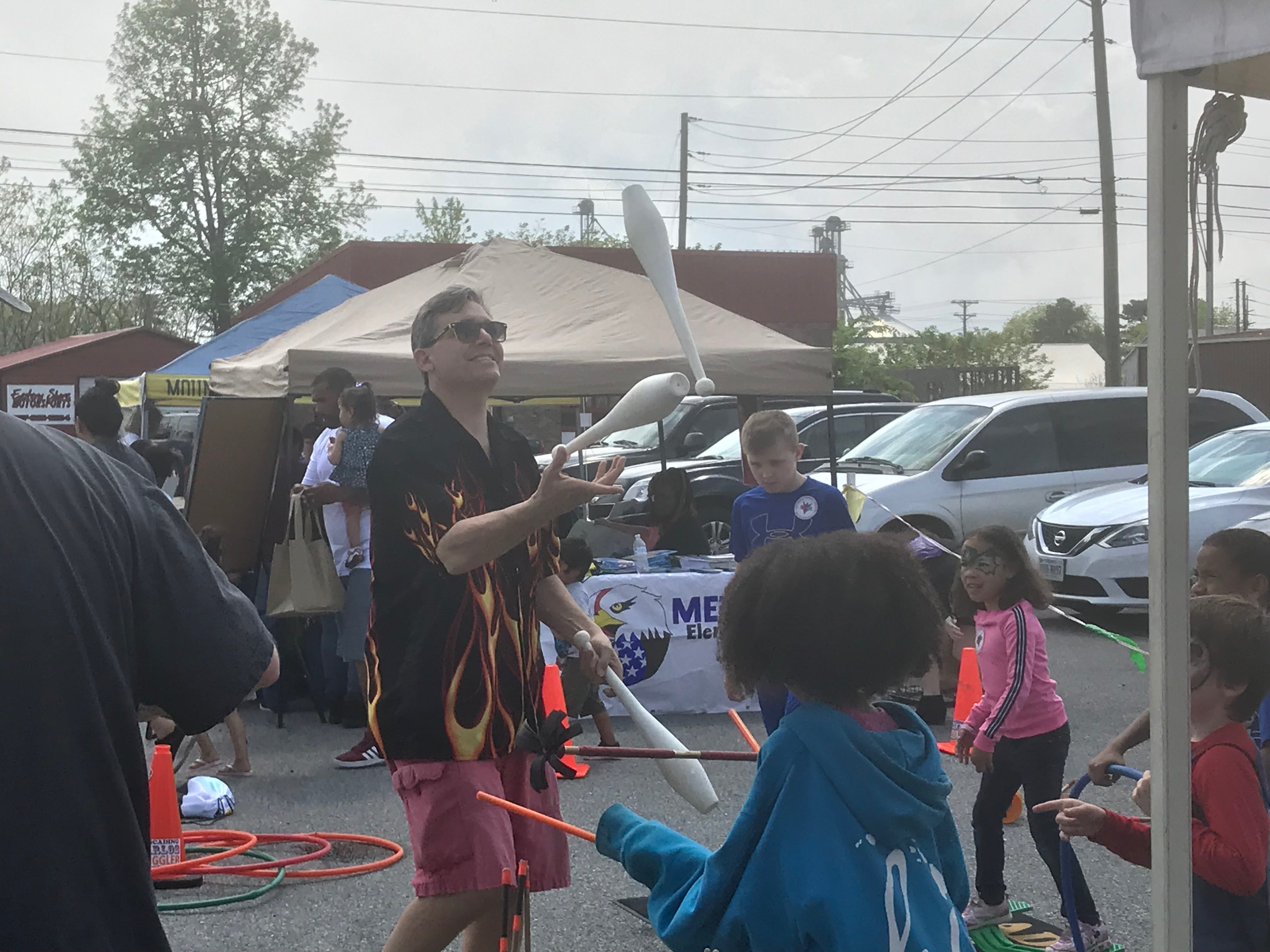 """Juggler 'Cascading Carlos,' demonstrates his skills during 'Celebrate Us,"""" a multicultural festival sponsored by the Eastern Shore Public Library and held at the site of the future regional library in Parksley, Virginia on Sunday, May 5, 2019."""
