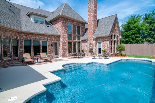 Relax poolside this summer at 207 Oak Alley in Bossier City.