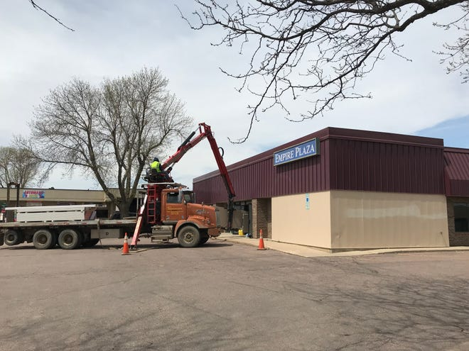 Crews load equipment into the future location of Sun 'N Fun at 3501 S. Kelley Ave. Sun 'N Fun staff plan to open the new store in June.