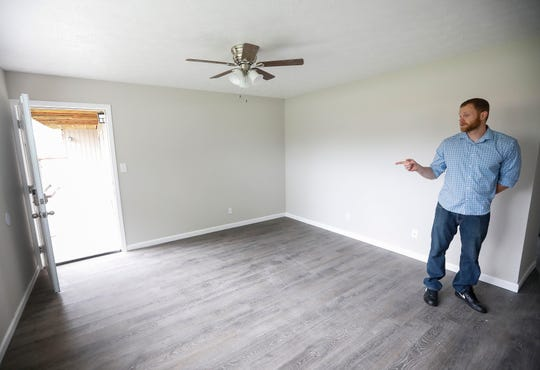 Adam Stacey, the new landlord of an apartment building at 2107 E Cherry St. that was previously owned by Chris Gatley, talks about one of the units he has cleaned up and renovated.