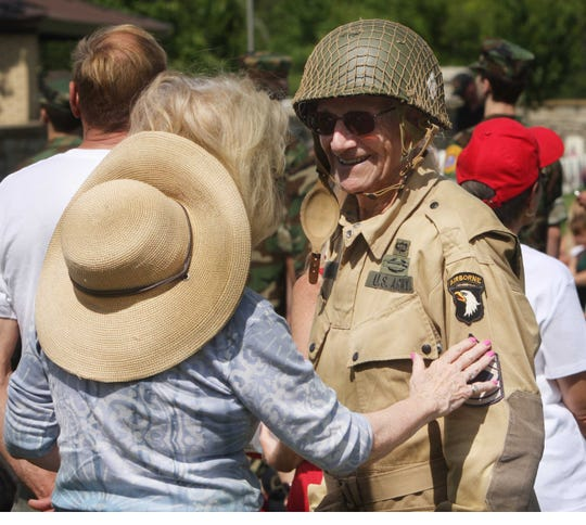Hundreds of people attended the Memorial Day ceremony at Springfield National Cemetery. Ralph Manley, right, visits with Roseann Bentley.