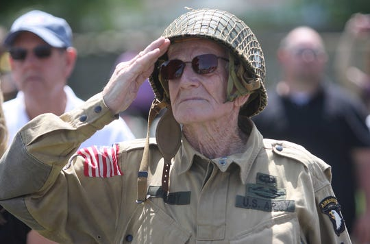 Hundreds of people attended the Memorial Day ceremony at Springfield National Cemetery. Ralph Manley salutes during the posting of the colors.