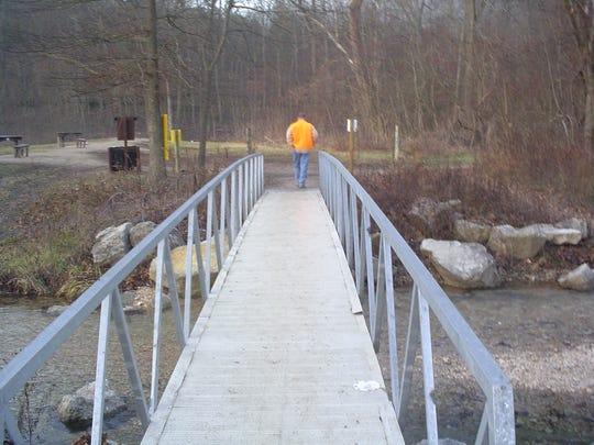 Thismetall footbridge leading to Busiek shooting range washed away last week.