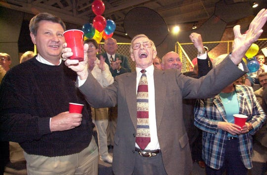 City Councilman Ralph Manley,center, throws his arms in the air as he celebrates the results of a School Bond vote in 1999.