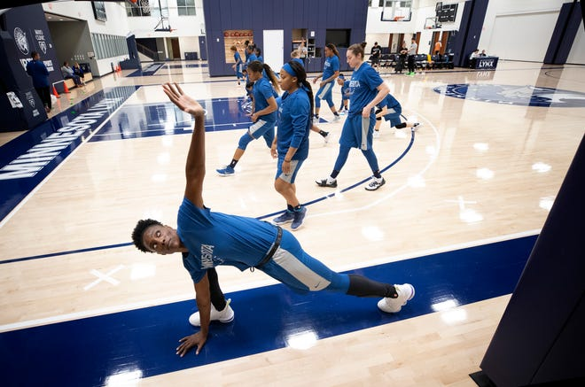 Minnesota Lynx's Sylvia Fowles. foreground, stretches during the first day of WNBA basketball training camp in Minneapolis, Sunday, May 5, 2019. (Carlos Gonzalez/Star Tribune via AP)
