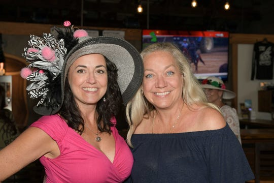 Connie Agler, left, and LaDeene Dodson at the Royal Palms' Kentucky Derby Party at the Walking Tree Brewery in Vero Beach.