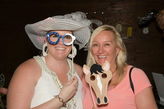 The Royal Palms President Justine Theisen, left, and Martha Taylor at the Royal Palms' Kentucky Derby Party at the Walking Tree Brewery in Vero Beach.