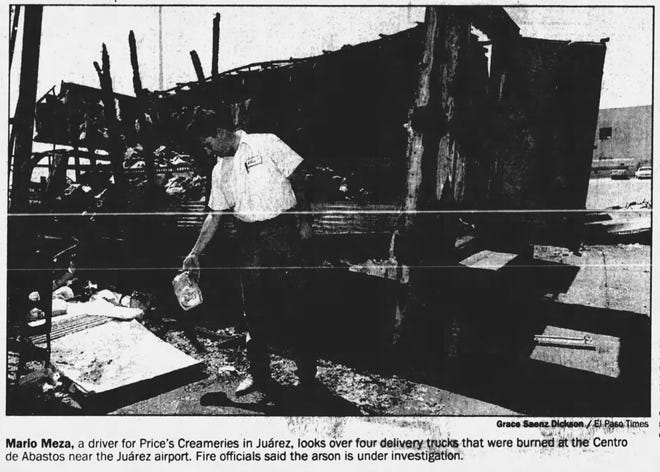 Aug. 5, 1994-Mario Meza, a drive for Price's Creameries in Juarez, looks over four delivery trucks that were burned at the Centro de Abastos near the Juarez airport. Fire officials said the arson is under investigation.