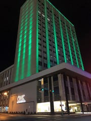 Find out why this building is sporting a green hue in May.
