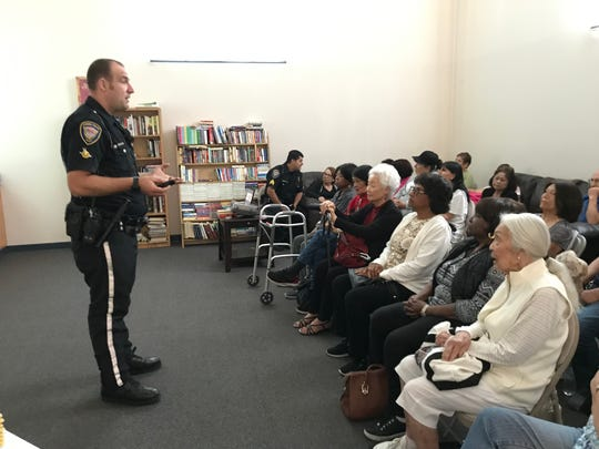 Officer Mike Wood of the Oxnard Police Department shares driving safety information to about 35 seniors citizens Monday at the South Oxnard senior center.