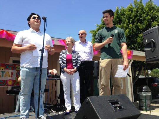 Chris Ehrman, ASB Organization vice president at St. Bonaventure High (left) and Nick Imig, ASB president, praise principals Marc and Pat Groff (center) during a celebration Sunday in Ventura.