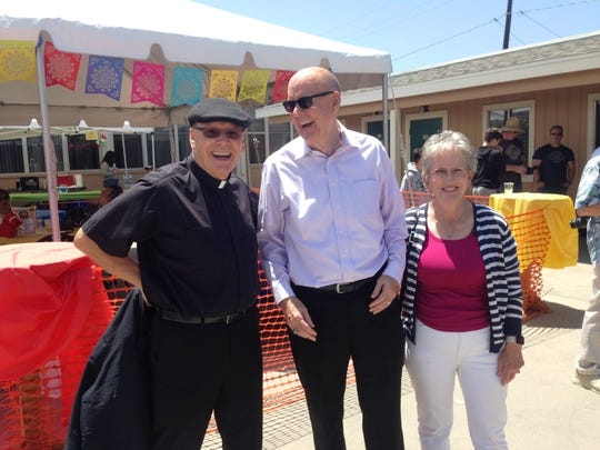 Father Leon Hutton, pastor at Our Lady of the Assumption Catholic parish in Ventura, poses for a snapshot Sunday with Marc and Pat Groff,  principals of neighboring St. Bonaventure High School and Our Lady of the Assumption Elementary. The couple, who have been married for 38 years, are retiring.