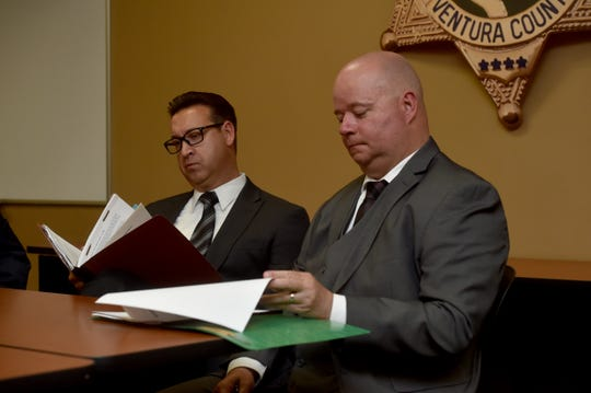 Detective Sgt. Dean Worthy, from left, and Detective Michael Marco, of the Ventura County Sheriff's Office, review their notes during an interview with The Star to discuss their ongoing investigation into the Nov. 7 shooting at the Borderline Bar & Grill in Thousand Oaks.