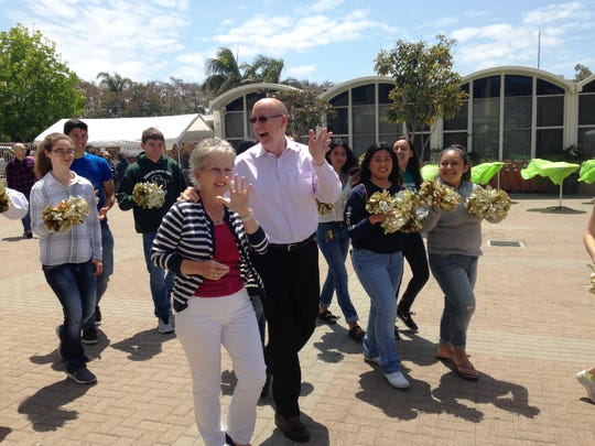 Pat and Marc Groff are escorted from Our Lady of the Assumption Catholic Church to St. Bonaventure High School in Ventura on Sunday. As principals of neighboring St. Bonaventure and Our Lady of the Assumption Elementary, the couple has guided thousands of young people on their journey to college and careers.