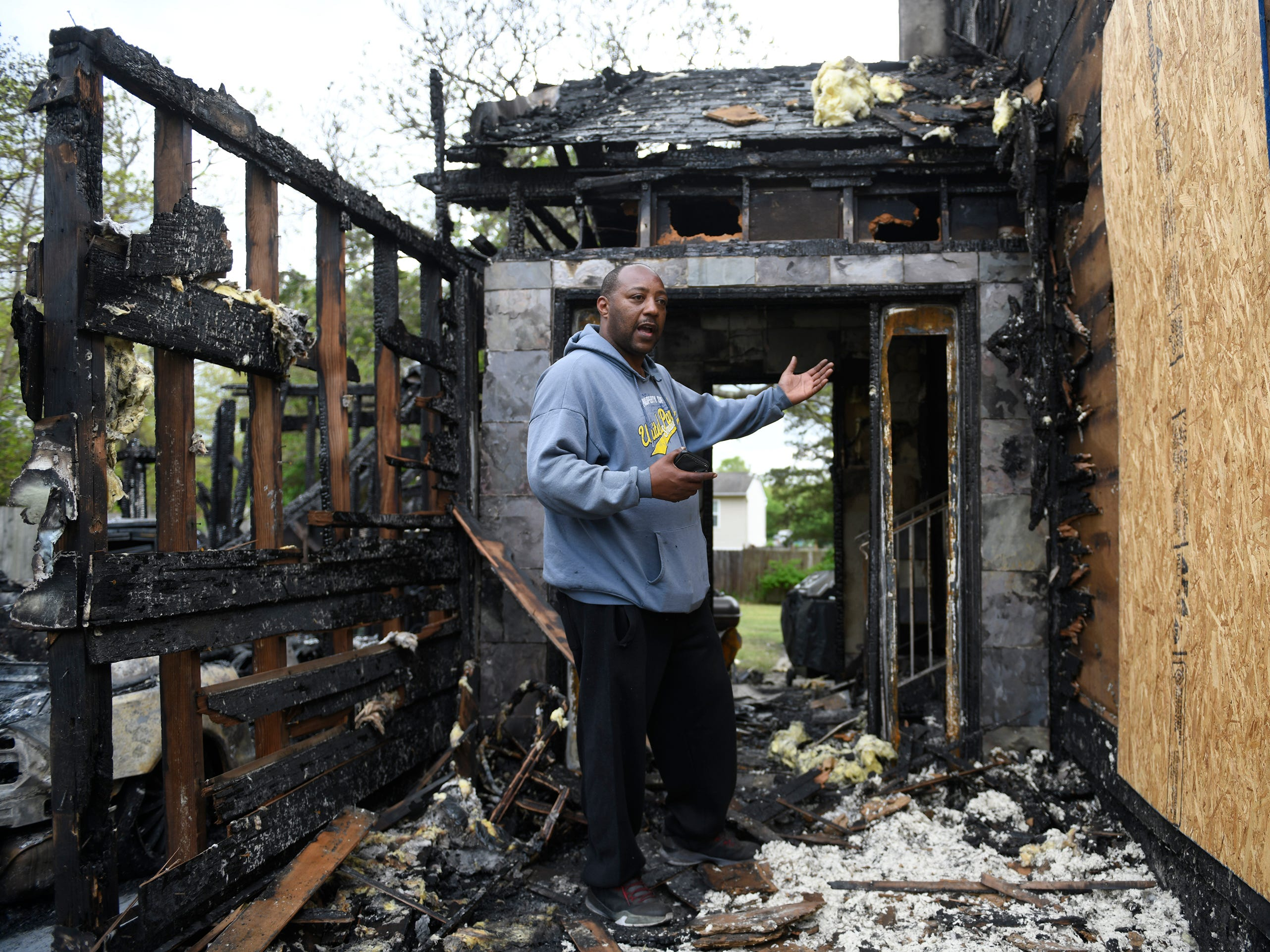 Anthony Rios stands in front of his charred home in Vineland following a fire on Monday, May 6, 2019. Rios says his Ring video doorbell system saved his life by alerting his family that there was a fire.