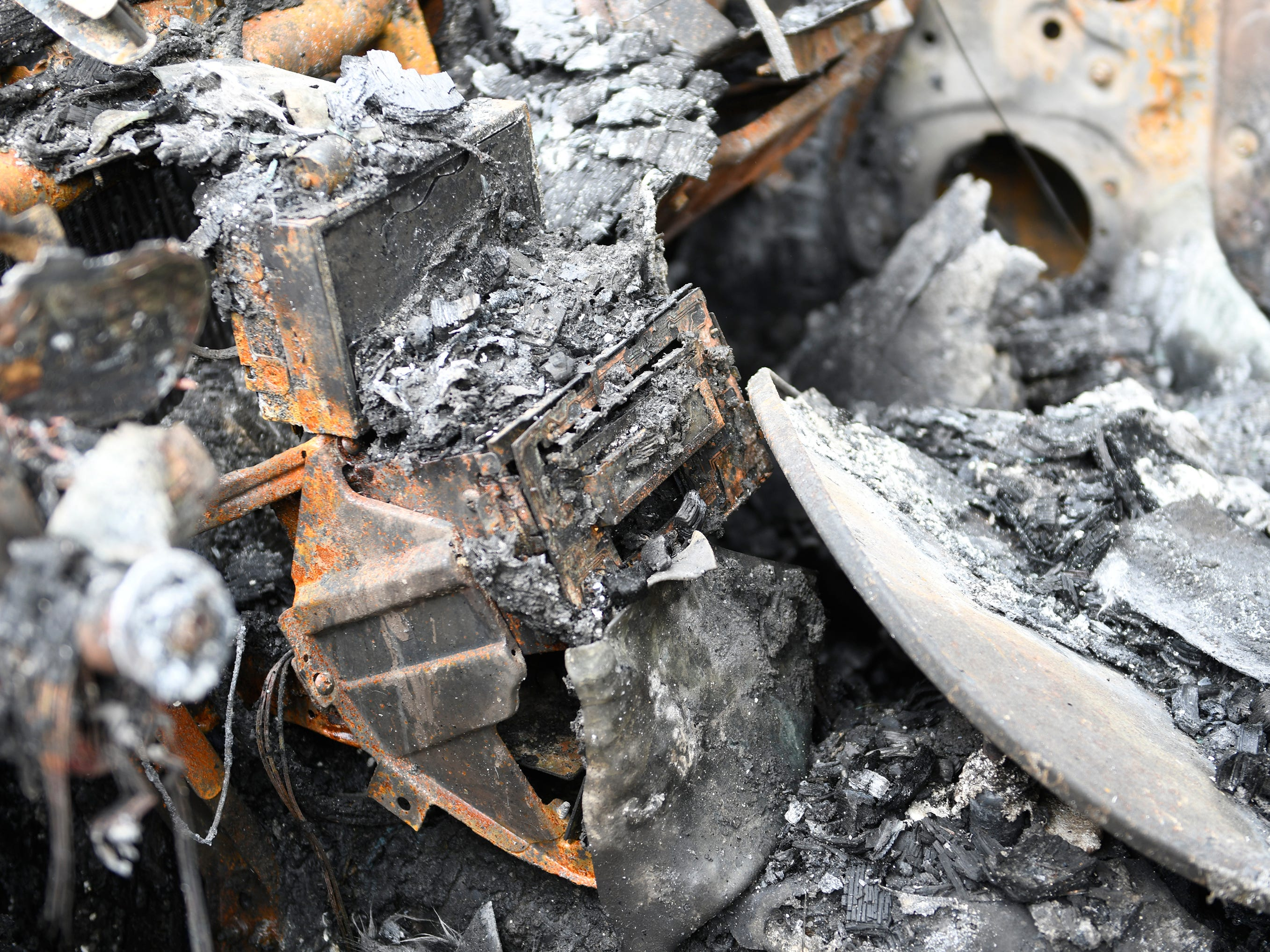 A car radio is barely recognized following Monday's house fire in Vineland.