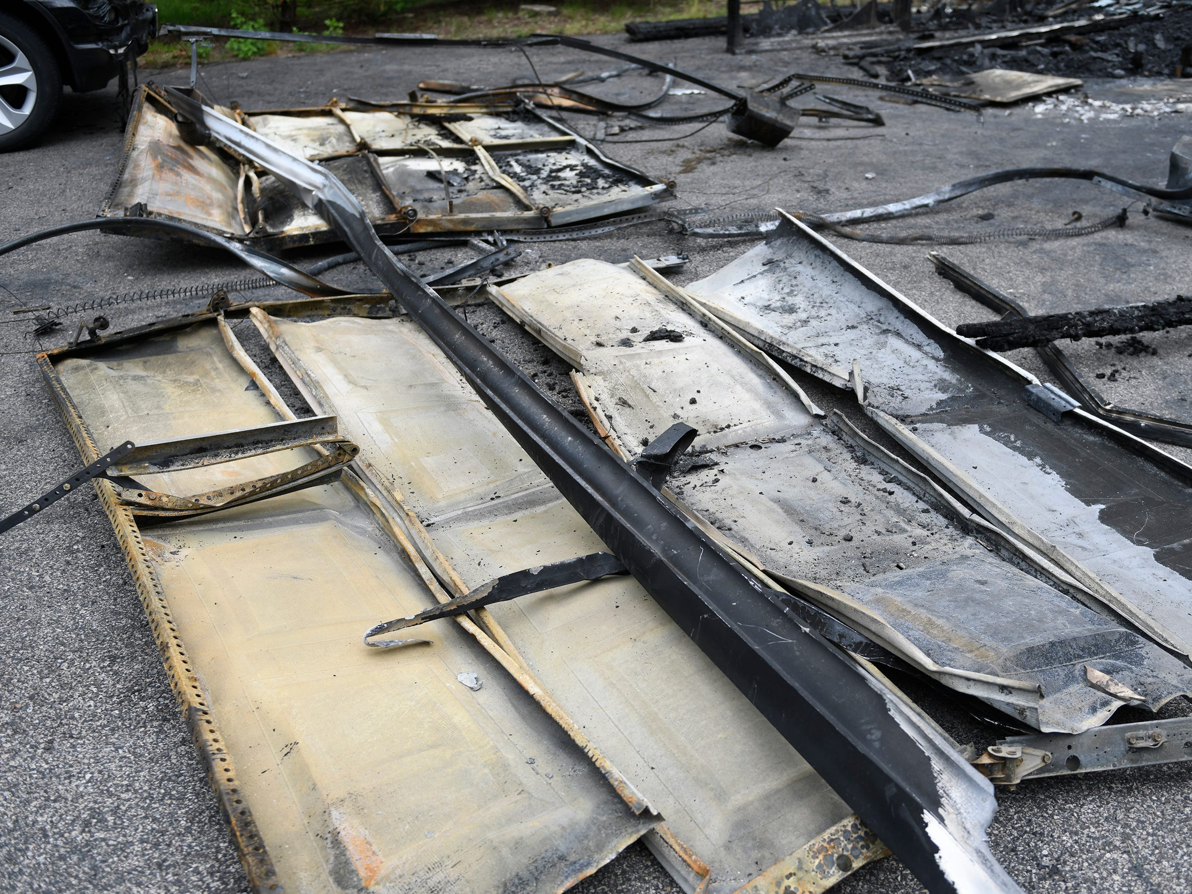 Both garage doors are pictured here warped from Monday's house fire on the 1700 block of West Oak Road in Vineland.