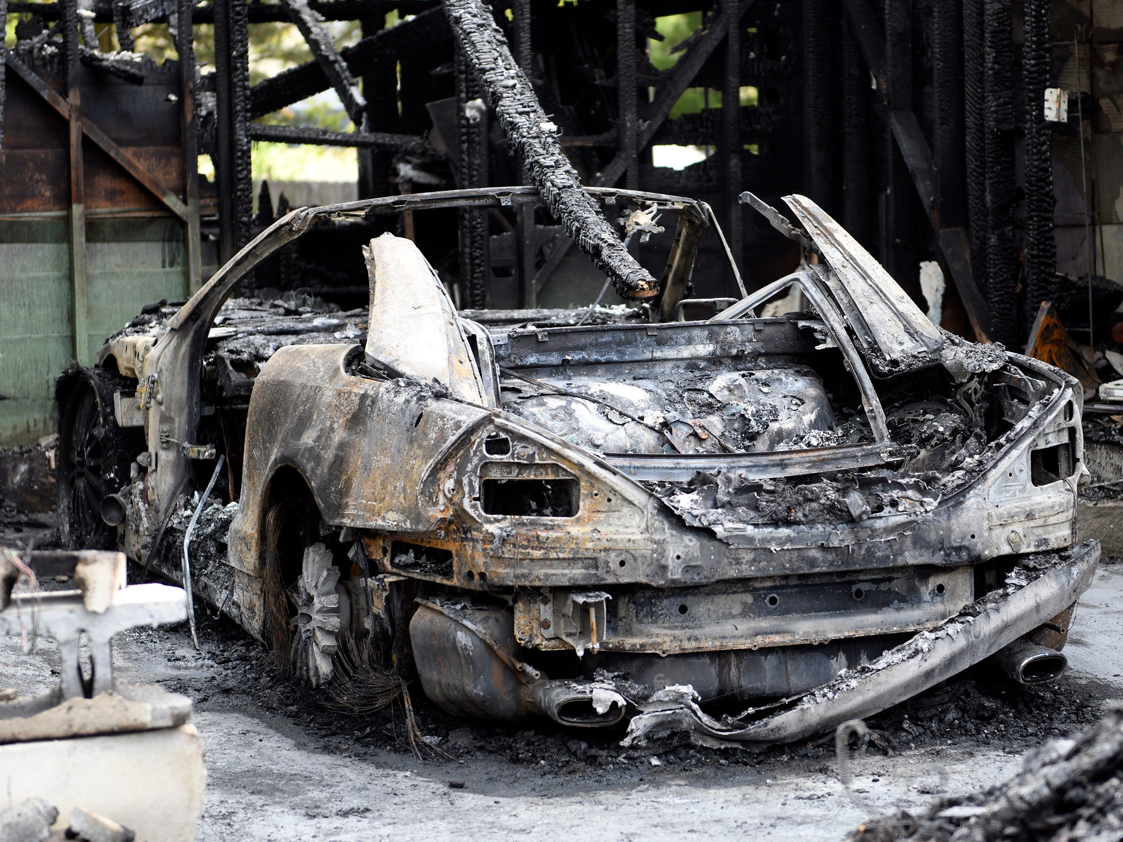A Nissan 350 ZX and a Mercedes SL 500, parked inside the garage, were destroyed in Monday's blaze.