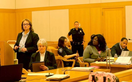 Westchester County Assistant District Attorney Mary Clark-Dirusso gives her opening statement in the murder trail of Derran Morris, far right,  at the Westchester County Courthouse May 6, 2019. Morris is on trial for the murder of one of his girlfriend's 2 1/2 year old twin daughters. Morris, sitting with his attorney Christina T. Hall, is also charged with seriously injuring the other twin.