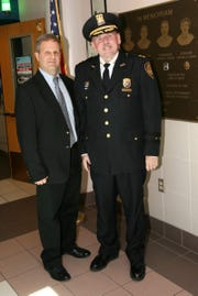 Orangetown's new police chief, Donald Butterworth, stands beside his predecessor, the recently retired Kevin Nulty.