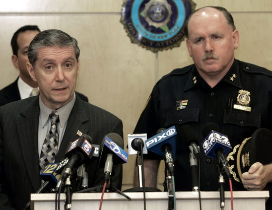 Rockland County District Attorney Thomas Zugibe, left, and Orangetown Police Chief Kevin Nulty speak at a press conference in New City June 16, 2009.