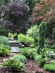 Dappled Berms is a lush one-acre garden tucked into a 1950s suburban neighborhood in Poughkeepsie, NY.