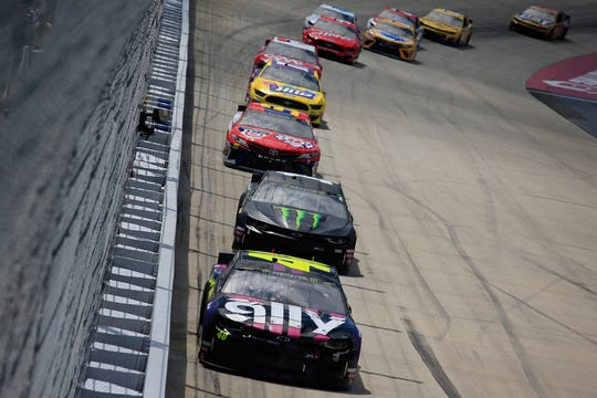 Jimmie Johnson, driver of the #48 Ally Chevrolet, leads a pack of cars during the Monster Energy NASCAR Cup Series Gander RV 400 at Dover International Speedway on May 6, 2019 in Dover, Delaware.