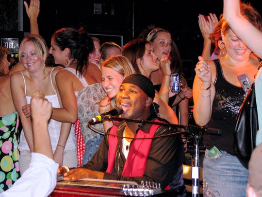 Robert Randolph and the Family Band performs as fans dance on stage at Dewey Beach's Bottle & Cork in 2007.
