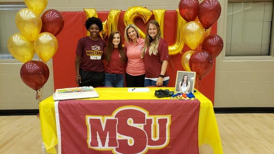 Lauren Spragins (second from left) recently signed to run track at Midwestern State University after completing a stellar high-school athletic career at Christ Academy.
