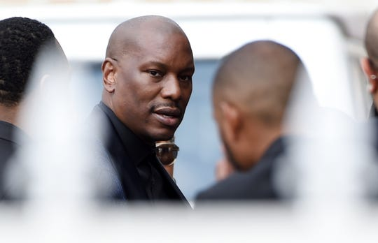 """Tyrese, who was a cast member in director John Singleton's 2001 film """"Baby Boy,"""" arrives at a memorial service for Singleton at Angelus Funeral Home in Los Angeles on Monday. Singleton died on April 29 following a stroke."""