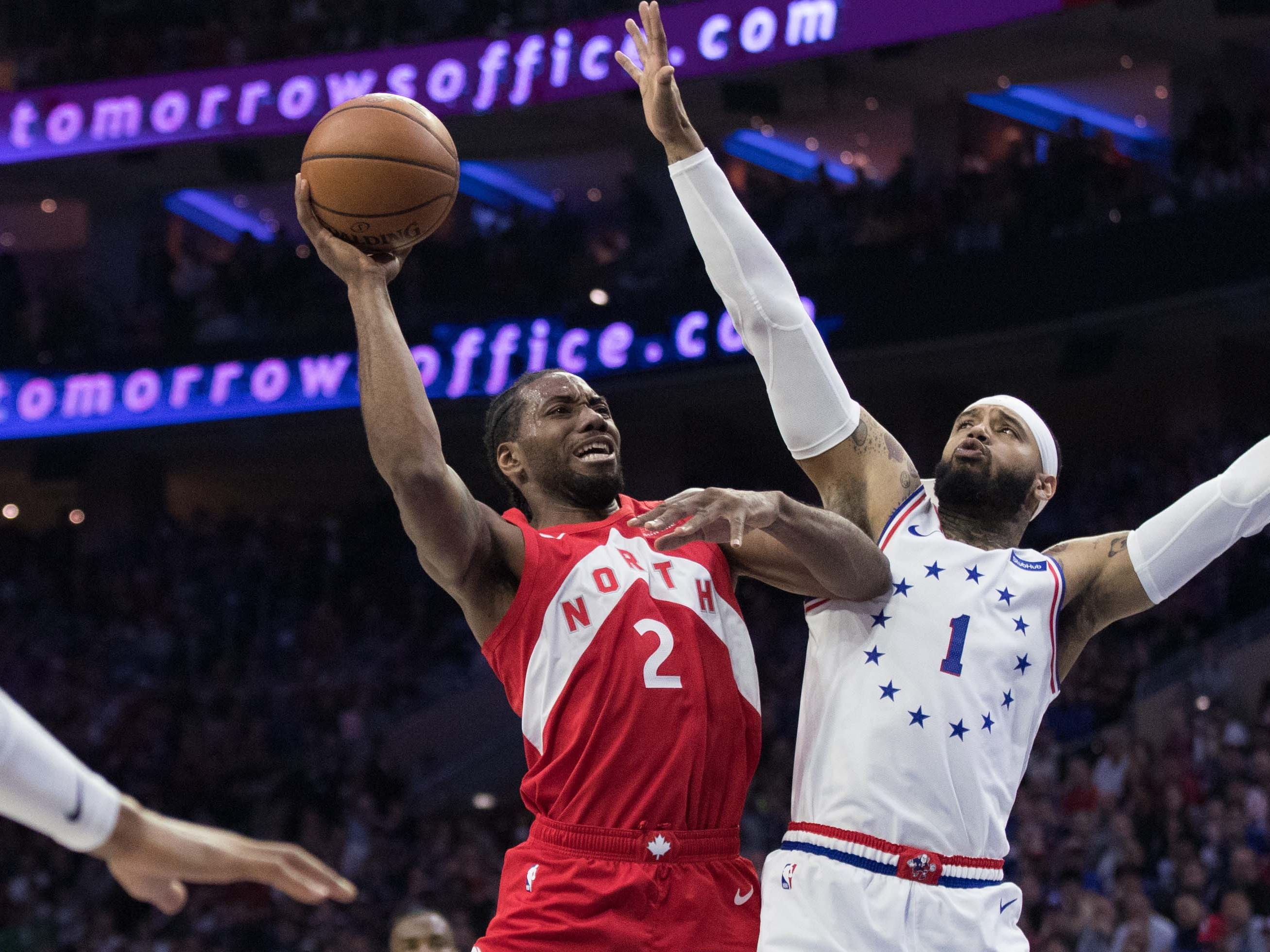 May 5: Raptors forward Kawhi Leonard (2) drives to the bucket against 76ers defender Mike Scott (1) during Game 4 in Philadelphia.