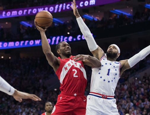 May 5: Raptors forward Kawhi Leonard (2) drives to the bucket against 76ers defender Mike Scott (1) during Game 4 in Philadelphia.