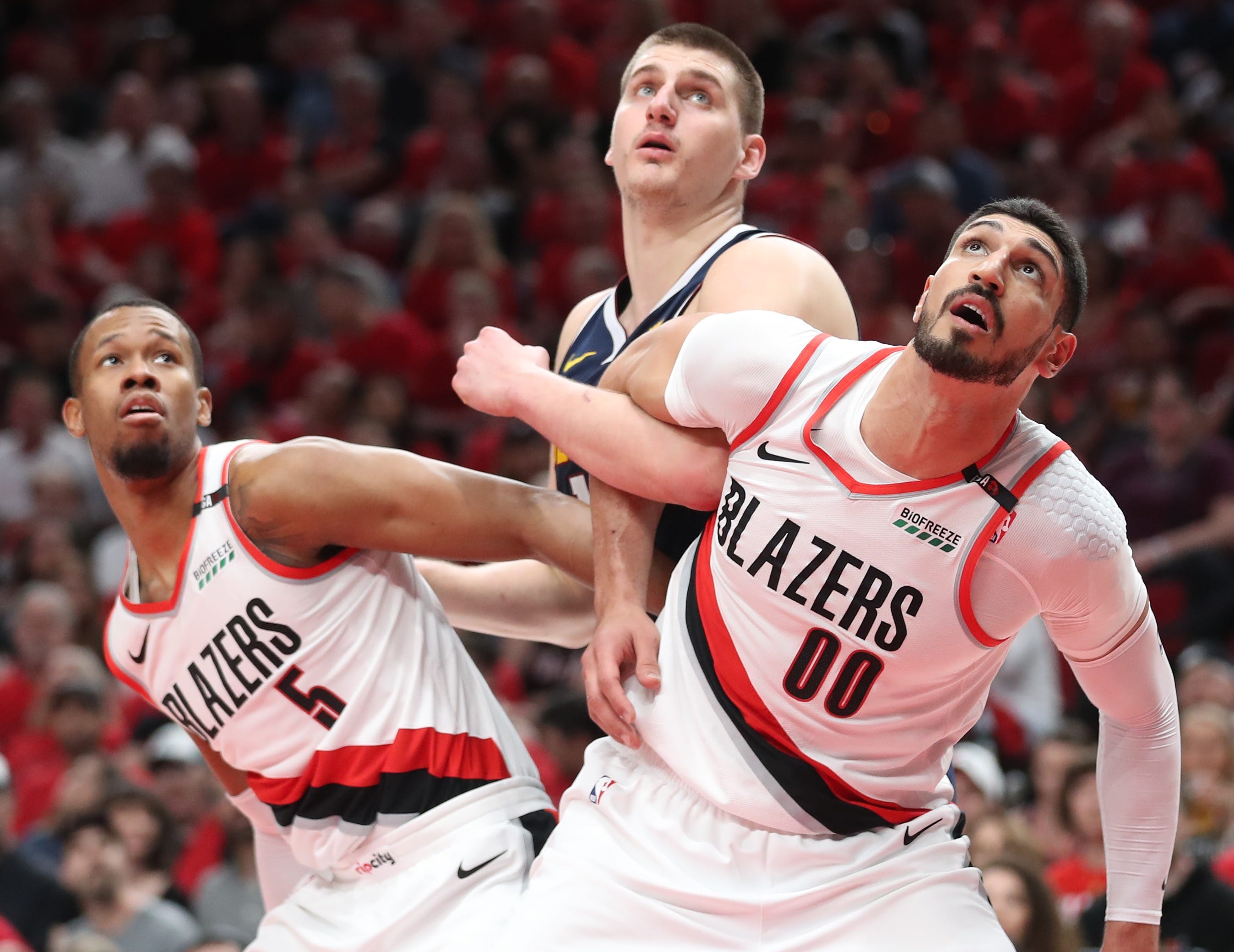 May 5: Blazers defenders Rodney Hood (5) and Enes Kanter (00) try to box out Nuggets center Nikola Jokic (15) during Game 4.