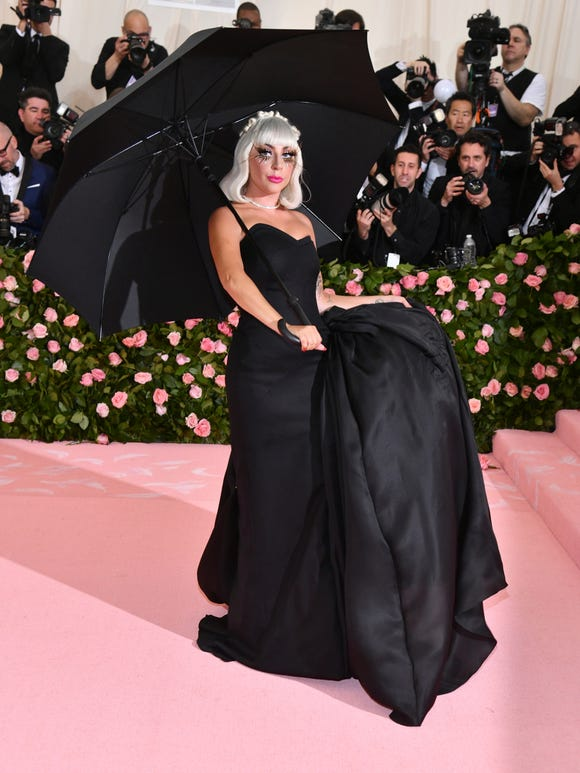 Look No. 2: Gaga drops her coat to reveal a black ballgown. Drama!
