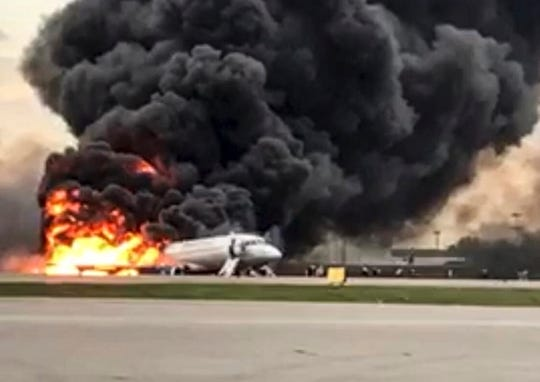 This image taken from a video distributed by Russian Investigative Committee on Sunday, May 5, 2019, shows the Sukhoi SSJ100 aircraft of Aeroflot Airlines on fire, at Sheremetyevo airport, outside Moscow, Russia.