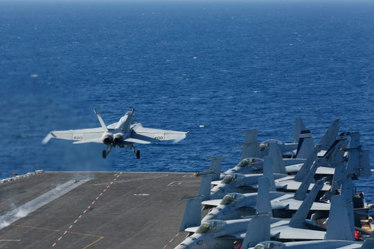 "In this May 3, 2019 photo released by the U.S. Navy, An F/A-18E Super Hornet from VFA 25 launches from the flight deck of the Nimitz-class aircraft carrier USS Abraham Lincoln. The U.S. is dispatching the USS Abraham Lincoln and other military resources to the Middle East following ""clear indications"" that Iran and its proxy forces were preparing to possibly attack U.S. forces in the region, according to a defense official on May 5, 2019. (Mass Communication Specialist Seaman Michael Singley/US Navy via AP)"