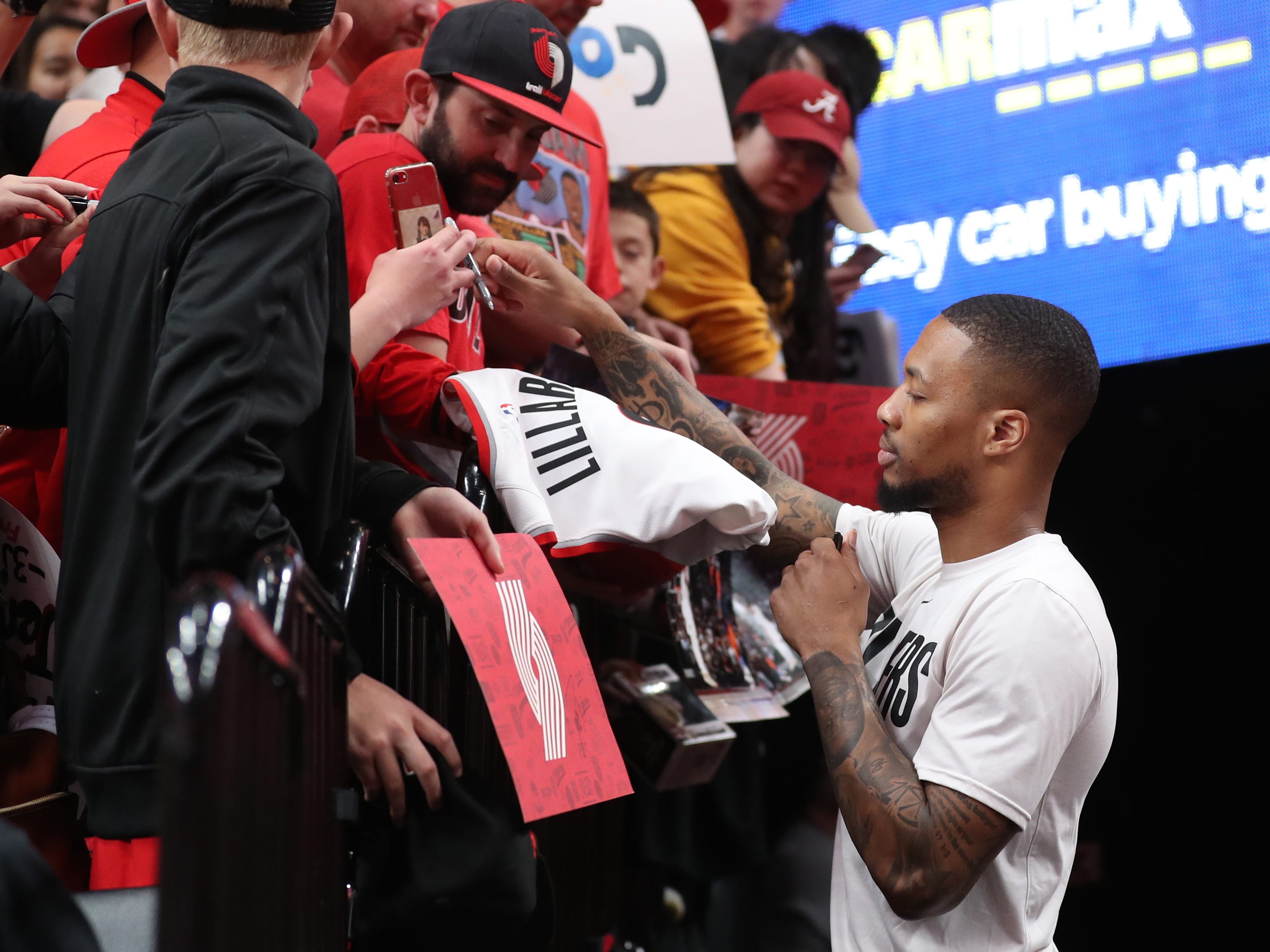 May 5: Blazers star Damian Lillard signs autographs prior to Game 4 against the Nuggets in Portland.