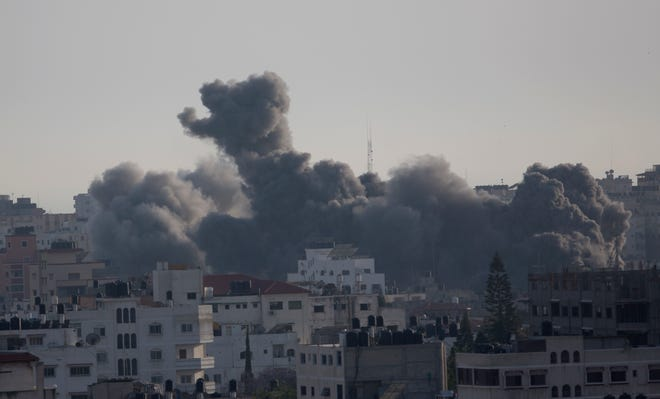 Smoke rises from an explosion after an Israeli airstrike in Gaza City, May 5, 2019. The Israeli military said Sunday it had responded to 450 rockets fired from Gaza with over 250 airstrikes against the besieged Palestinian enclave.
