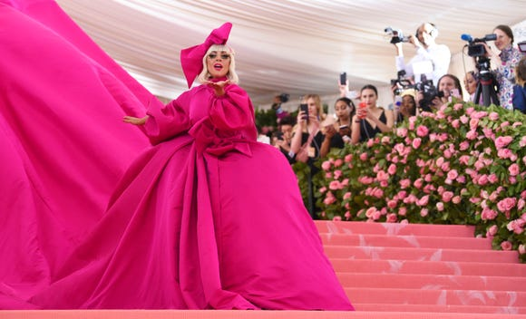 Look No. 1: Gaga turns her Met Gala entrance into a piece of performance art when she steps on the carpet.