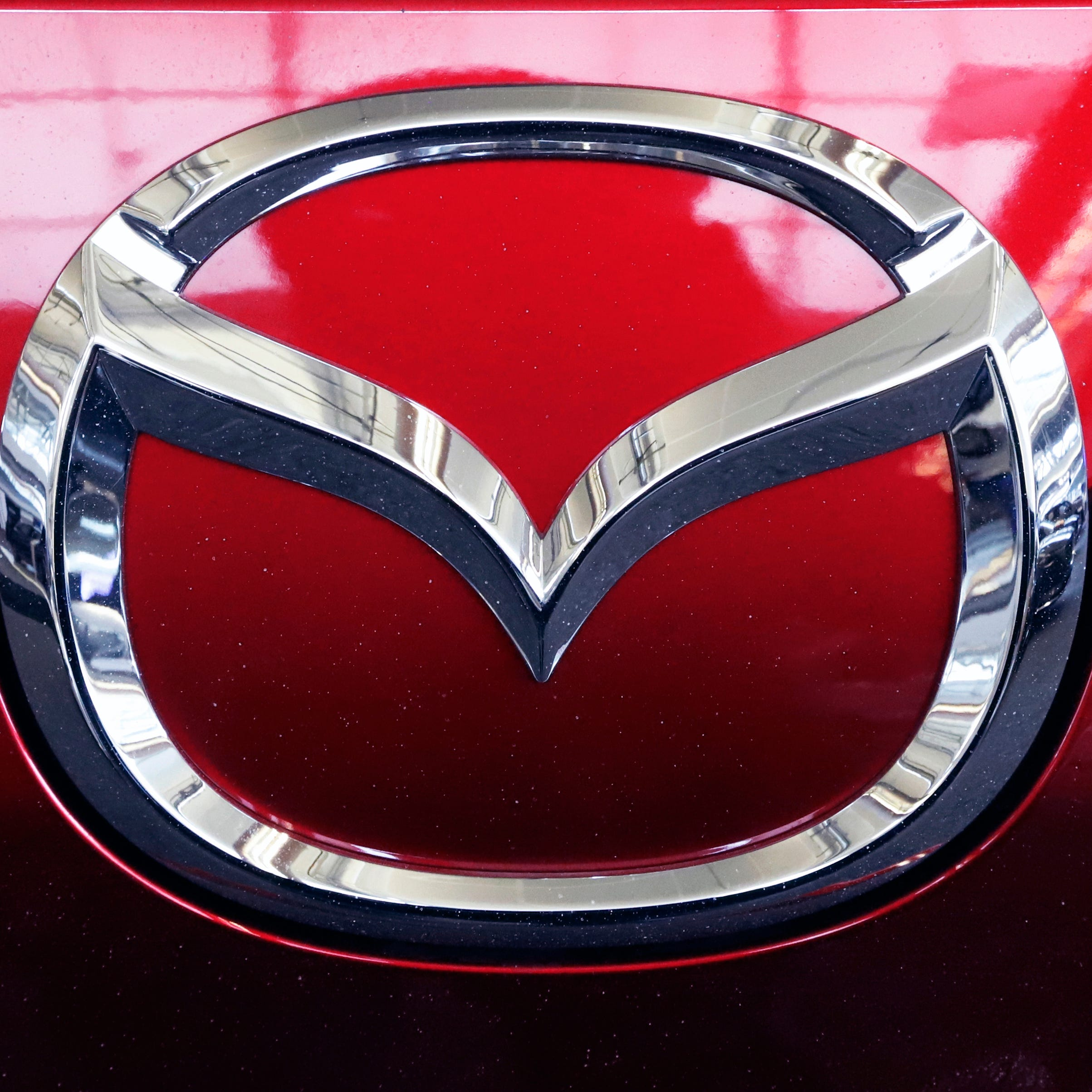 This Feb. 14, 2019, file photo shows the Mazda logo at the 2019 Pittsburgh International Auto Show in Pittsburgh.