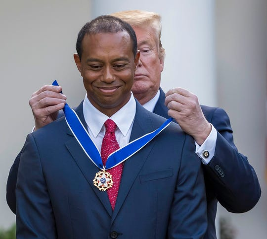 Donald Trump presents the Presidential Medal of Freedom to Tiger Woods.
