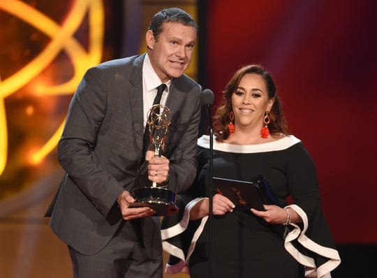 "Alan Tacher and Glicia Marquez-Pronesti accept the award for outstanding morning program in Spanish for ""Despierta America"" at the 46th annual Daytime Emmy Awards."
