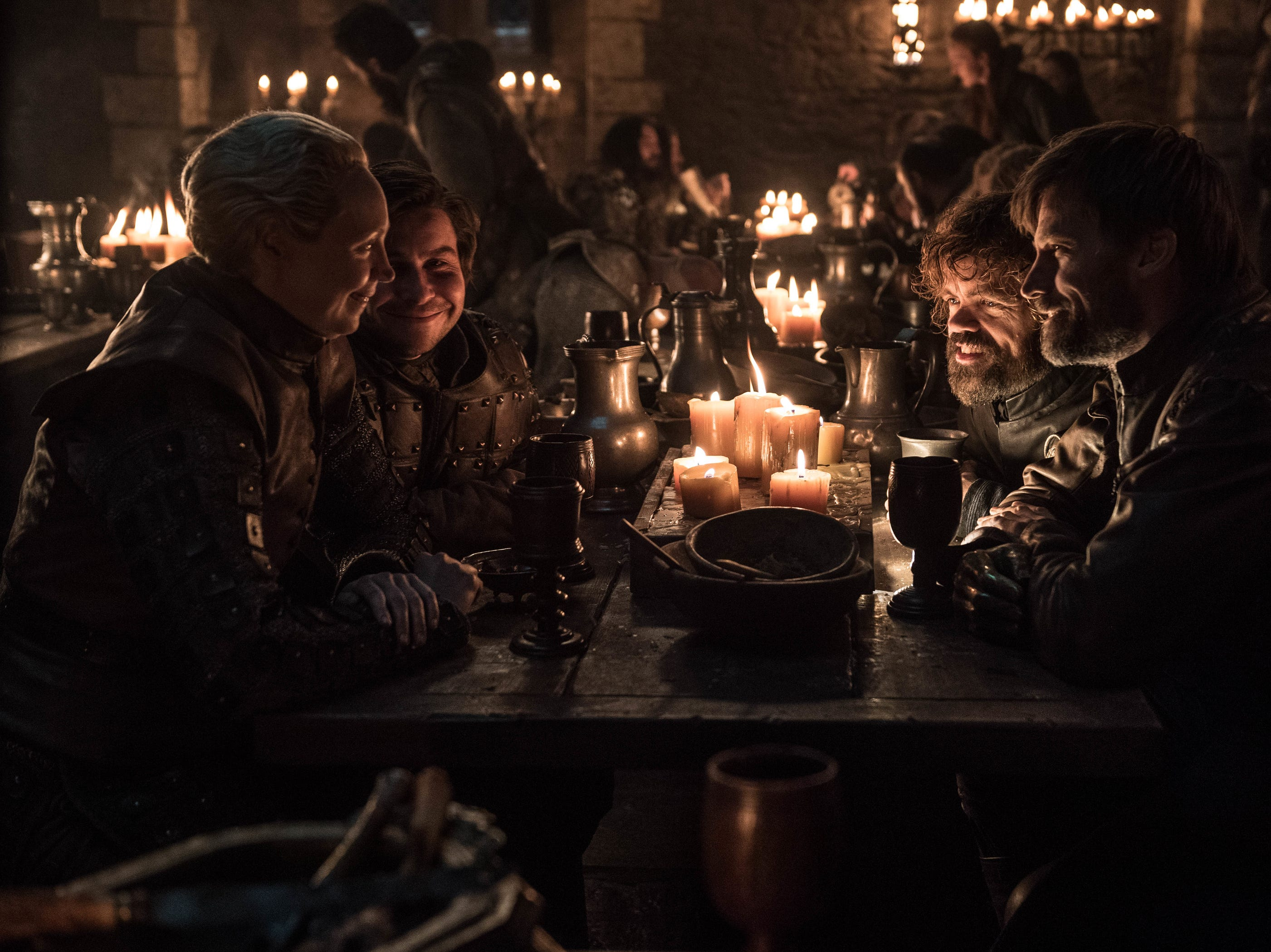 Brienne of Tarth (Gwendoline Christie), left, Podrick (Daniel Portman), Tyrion Lannister (Peter Dinklage) and Jaime Lannister (Nikolaj Coster-Waldau) take part in a drinking game during the Winterfell celebration.