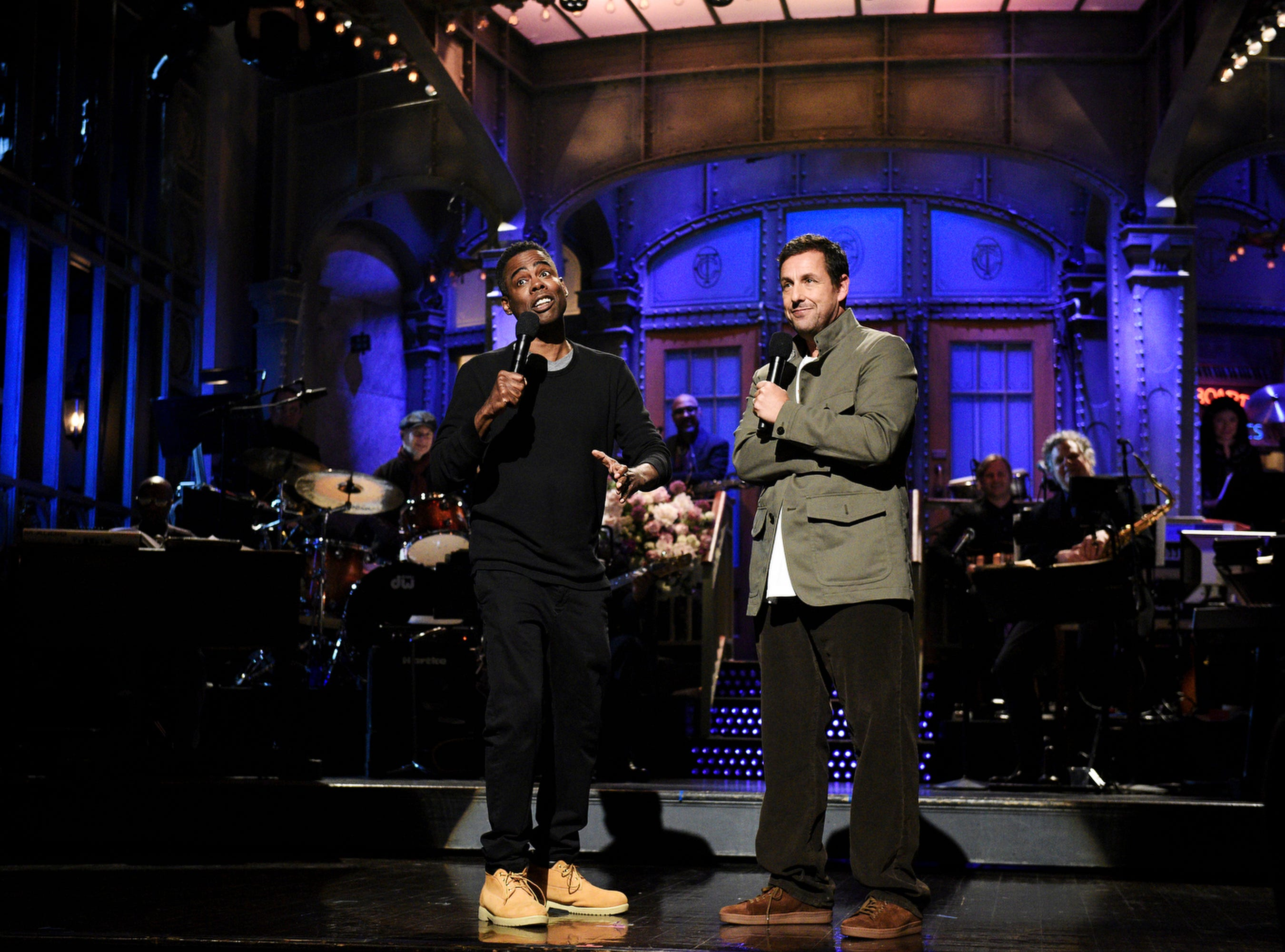 """Adam Sandler returned to """"SNL"""" with a song during his monologue about getting fired from the show. Chris Rock also showed up as a guest to help out his former co-star."""